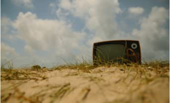 Television stuck in a sand dune