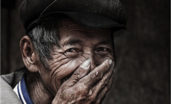 photo of an elderly man laughing