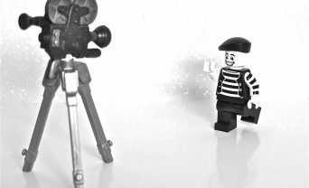 indoor filming with lego character and video camera