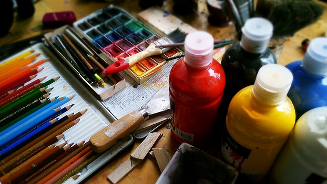 Paints displayed on a wooden table